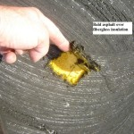 Bald asphalt roofing over fiberglass insulation - example