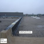 Spray foam roof area ties-in to asphalt-gravel area - example